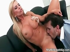 Sexy blonde MILF with big tits Amber
