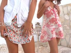 Dancing duet of two delicate brunettes