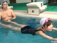 Swimming instructor rubs asian pussy