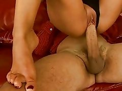 Sexy brunette does footjob and riding big cock